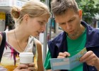 Couple in City Looking at Map