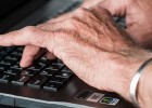 Elderly Person Hands Typing